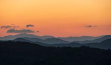 USA, Georgia, Orange Sky Above Blue Ridge Mountains At Sunrise