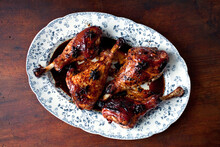 Overhead View Of Roasted Turkey Drumsticks With Star Anise And Soy Sauce Served On Plate