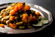 Close Up Of Giant Lima Beans With Squash Served On Plate