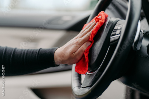 Mans hand cleaning luxury car interior Canvas Print