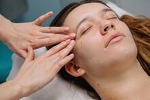 Crop Hands Doing Face Massage