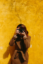 Photographer Woman On Yellow Background.