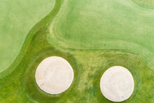 Aerial Top Down Views Of Golf Course Greens, Bunkers And Fairway