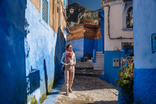Tourist Waking In Dead End With Colorful Houses
