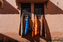 Bright Cloths Hanging On Windo...