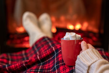 Woman With Cup Of Hot Cocoa An...
