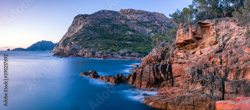 early morning light on the coastal cliffs on Freycinet Peninsula Tasmania