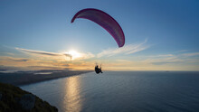 Paragliding On The Beach At Su...