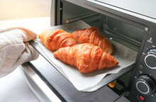 Croissant Was Taken Out From Mini Oven Ready To Serve - Morning Breakfast Concept