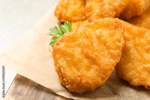 Tasty fried chicken nuggets on light grey table, closeup Billede på lærred