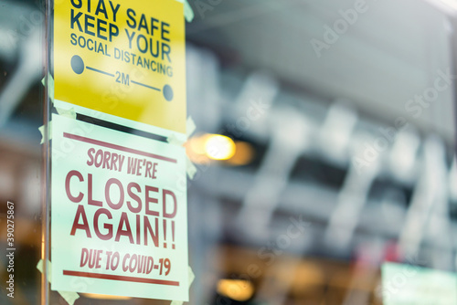window store glass door entrance handing closed sign shop again from covid-19 sp Canvas
