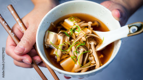 Fotografie, Obraz Hands holding Japanese mushroom soup