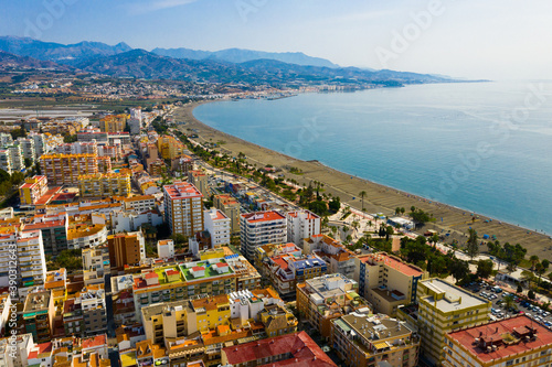 Obraz Scenic aerial view of Spanish tourist town of Torre del Mar on Mediterranean coast in sunny autumn day, province of Malaga.. - fototapety do salonu