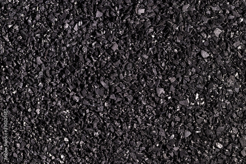 Photo Close-up activated carbon texture. Coconut charcoal.
