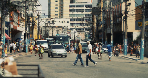 Photo RIO DE JANEIRO, BRAZIL - Oct 06, 2020: People walking on the streets of a poor c