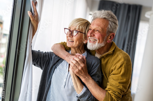 Papel de parede Happy senior couple in love hugging and bonding with true emotions
