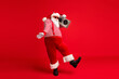 Full length body size view of his he handsome bearded fat overweight cheery Santa listening pop carrying tape player dancing having fun isolated bright vivid shine vibrant red color background