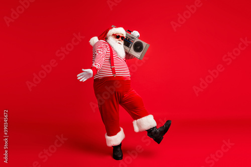 Fototapeta Full length body size view of his he handsome bearded fat overweight cheery Santa listening pop carrying tape player dancing having fun isolated bright vivid shine vibrant red color background obraz