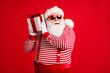 Portrait of his he nice handsome attractive bearded cheerful Santa father holding in hands giftbox guessing what's inside idea isolated bright vivid shine vibrant red color background