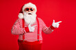 canvas print picture Portrait of his he nice handsome attractive glad cheerful bearded fat gray-haired Santa demonstrating copy empty blank place space isolated on bright vivid shine vibrant red color background