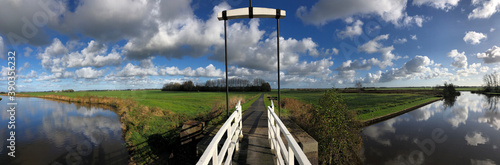 Panoramic from a bridge over a canal in a nature reserve Fototapeta