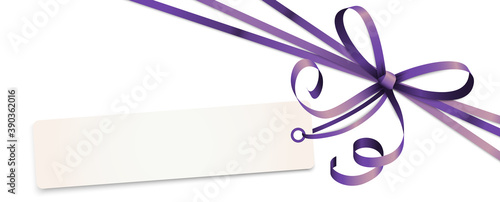 Leinwand Poster purple colored ribbon bow with hang tag