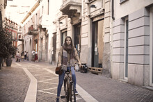 Young Woman Cycling In The City
