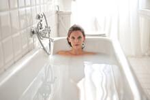 Beautiful Woman In Bath Tub Fi...