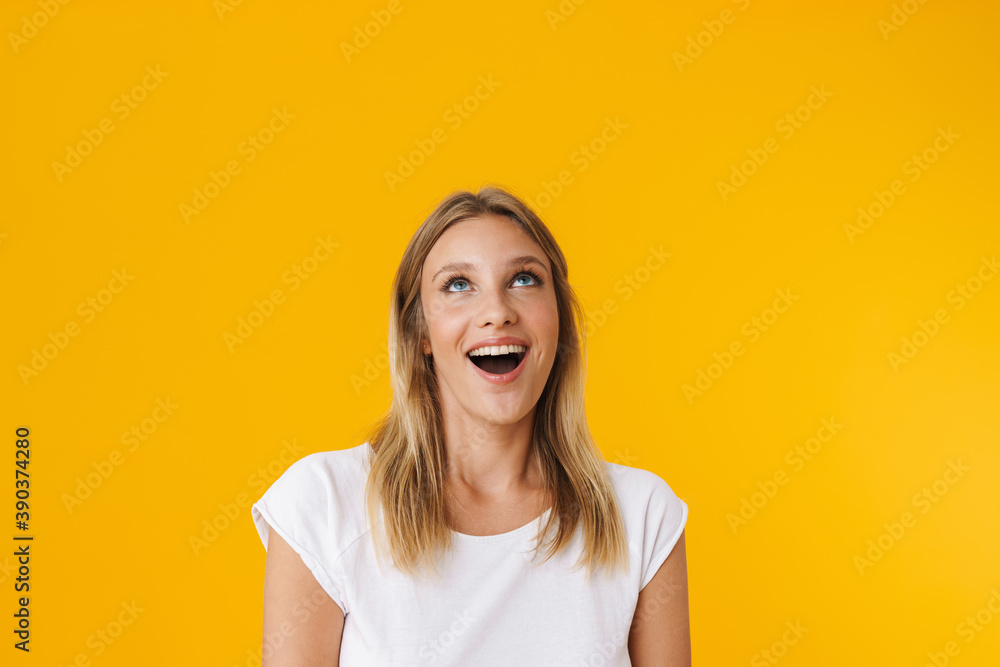 Fototapeta Excited beautiful girl smiling and looking upward