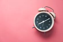 Old Alarm Clock On Pink Backgr...