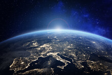 Planet Earth Viewed From Space With City Lights In Europe. World With Sunrise. Conceptual Image For Global Business Or European Communication Technology, Elements From NASA