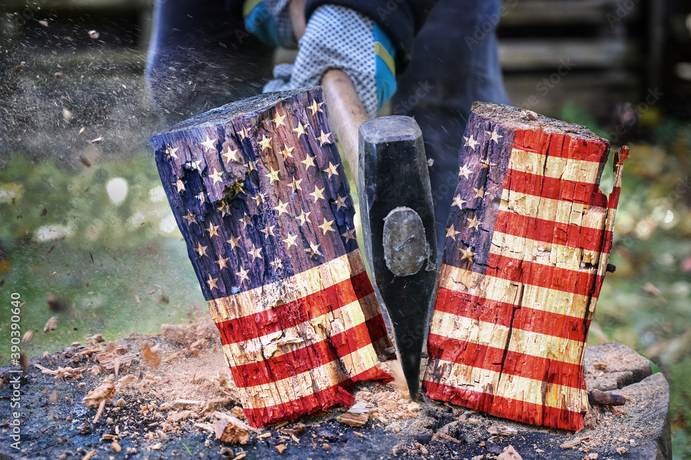 Fototapeta Wooden block with American flag is split in two halves with an axe, metaphor for the divided country after the election