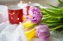 Beautiful Morning, Two Cups Of Coffee And A Bouquet Of Bright Tulips