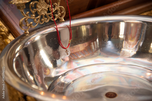 Slika na platnu baptismal font for a child with an Orthodox cross