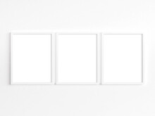 Three 8x10 White Frames With Portrait Orientation. 3D Illustration.