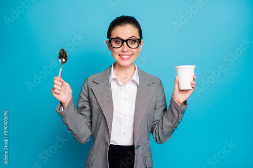 Obraz na plátně Portrait of attractive hungry cheerful funny lady eating tasty yummy lunch milky