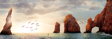 Rocky Formations On A Sunset Background. Famous Arches Of Los Cabos. Mexico. Baja California Sur. Panoramic Image. Banner Format.