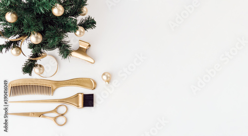 Photo Banner with hairdressing tools in gold color and a Christmas tree on a white background