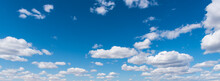 Blue Sky With Puffy White Clouds Background-3