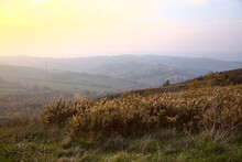 Hill Slopes At Sunset In Autum...