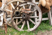 An Old Wooden Cart Wheel Stand...