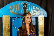 Portrait Of A Young Beautiful Girl In The Costume And Image Of The Ancient Egyptian Pharaoh Cleopatra Or Nefertiti