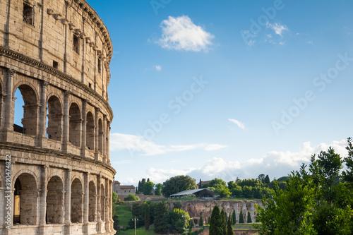 Close up of colloseum Rome, blue skies, golden yellow, history, momunemt, roman Fotobehang