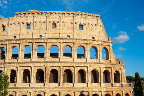 Close up of colloseum Rome, blue skies, golden yellow, history, momunemt, roman Canvas