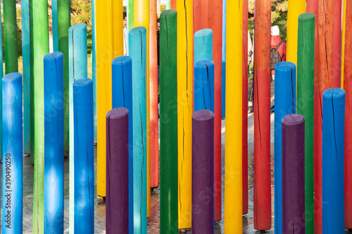 Obraz lumber painted in rainbow colours stands vertically on the playground - fototapety do salonu
