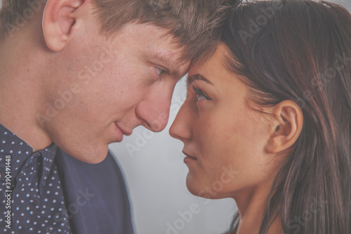 Tela Close up of young loving sensual couple enjoying intimacy tenderness in love