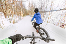 Couple Biking On Fat Bikes On ...