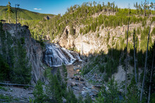 Gibbon Falls Waterfall In Yellowstone National Park. Daytime Long Exposure