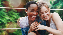 Cheerful Girls Embracing Each ...