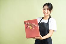 Asian Female Waitress Holding ...